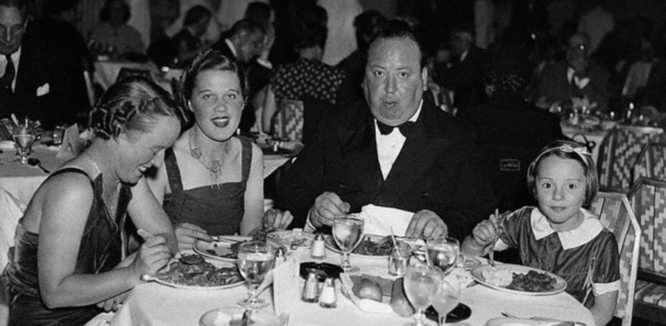 Hitchcock dining in a New York restaurant in August 1937 with his wife Alma, assistant Joan Harrison, and daughter Patricia.
